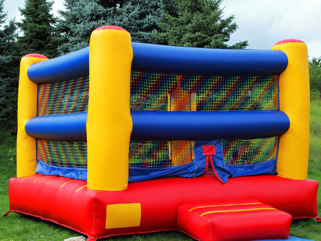 brightly coloured boxing ring style bouncy house