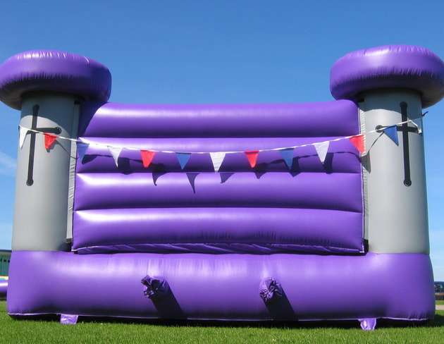 Old medieval style purple and gray bouncy castle