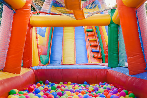 large bouncy castle slide with a ball pit at the end of the slide